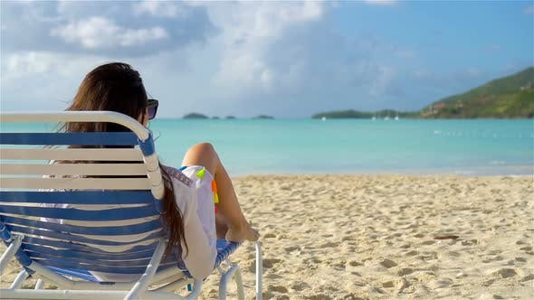 Thumbnail for Woman Sunbathing on a Lounger at Tropical White Beach