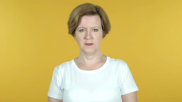 Thumbnail for Old Woman Looking at Camera Isolated on Yellow Background