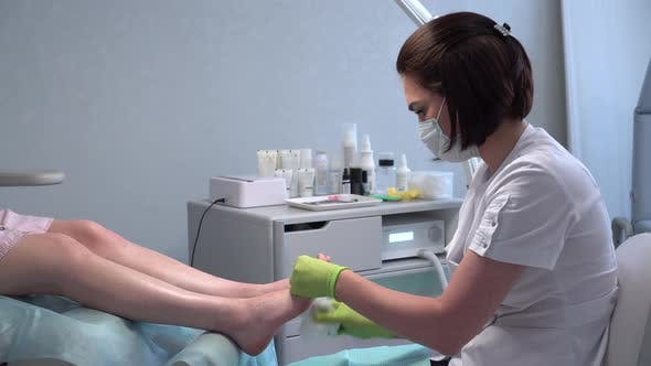 Padologist Prepares the Legs for the Procedure
