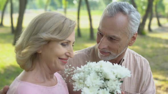 Thumbnail for Old Man Giving Bunch of Flowers to Wife, Celebrating Marriage Anniversary