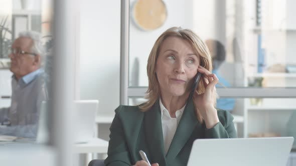 Thumbnail for Middle-Aged Businesswoman Negotiating with Client on Phone then Smiling