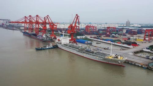 Aerial Footage Of A Large Cargo Ship Berthing At The Dock V5