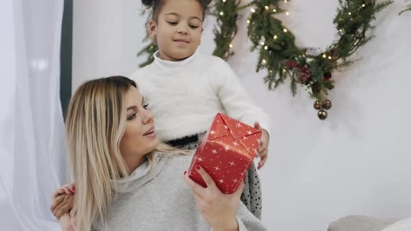 Thumbnail for Mother Receiving Gift From Her Daughter on Christmas Eve