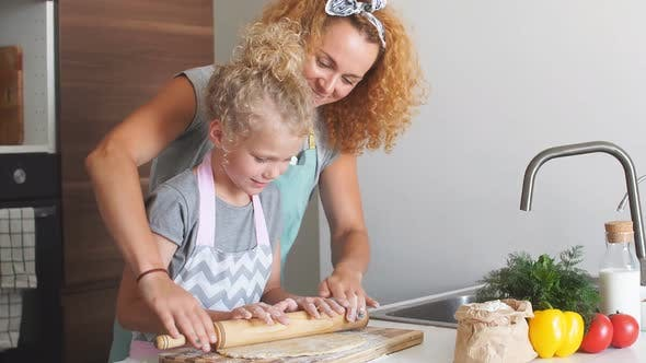 Thumbnail for Young Little Girl Helping Her Mother Prepare Bread for the Holiday