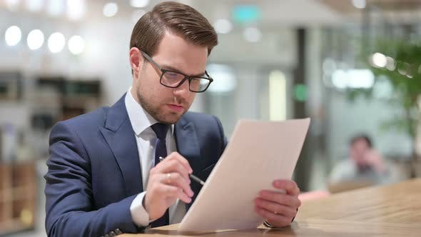 Thumbnail for Professional Businessman Reading Documents at Work
