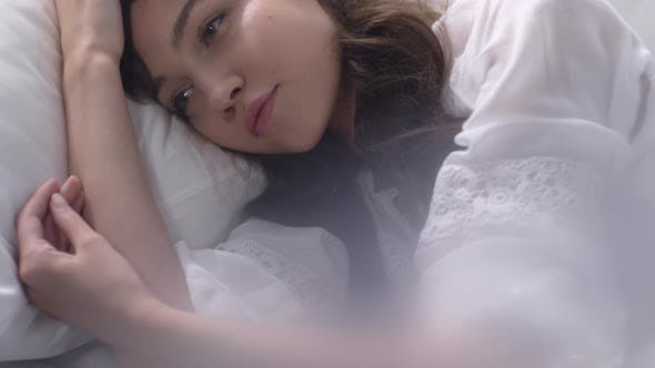 Thumbnail for Young Woman Waking Up