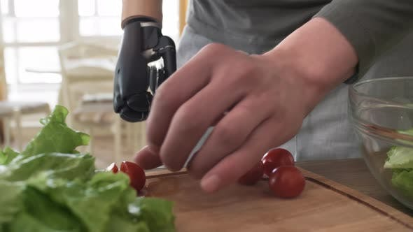 Thumbnail for Man with Myoelectric Prosthetic Arm Cutting Tomatoes
