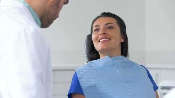 Thumbnail for Dentist and Patient Talking at Dental Clinic