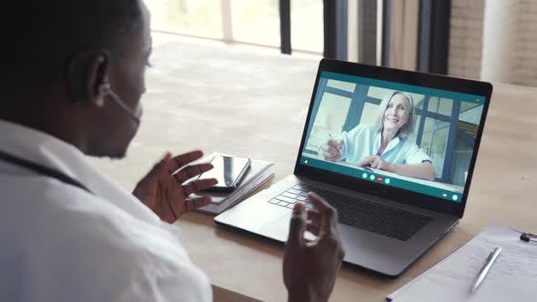 Black Male Doctor Consulting Senior Patient By Telemedicine Online Video Call