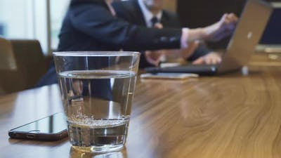 A Glass of Water and an iPhone That Lie on a Table