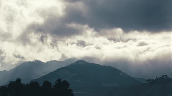 Cover Image for The Cayambe Mountain during a cloudy day as seen from Quitsato Sundial (medium shot)