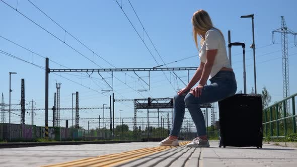Thumbnail for A Young Beautiful Woman Waits for a Train - View From Ground
