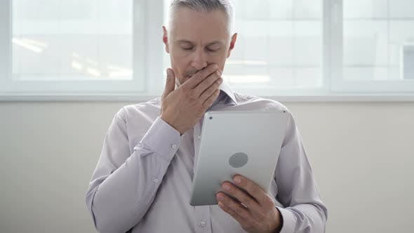 Thumbnail for Shocked, Astonished Middle Aged Man Using Tablet