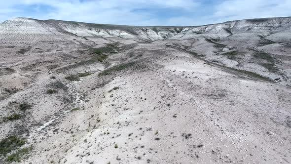 Thumbnail for White Limestone Mesa Hill Topography on Plain in Arid Barren Geography