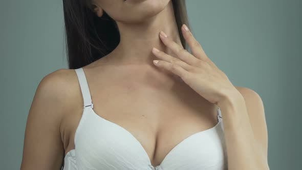 Thumbnail for Beautiful Woman Touching Neck and Shoulders with Fingertips, Smiling, Youth