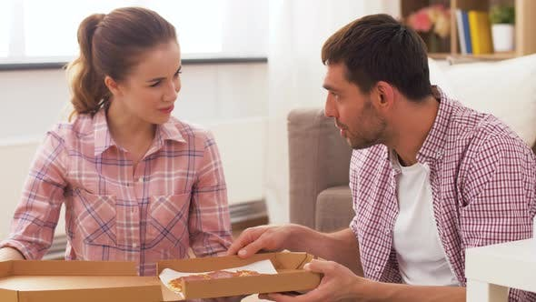 Thumbnail for Couple Eating Takeaway Pizza at Home