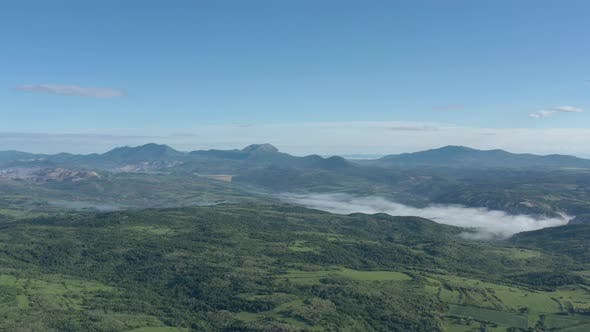 Thumbnail for Misty morning scenery with Stol Deli Jovan and Velik Krsh mountains in background 4K drone video