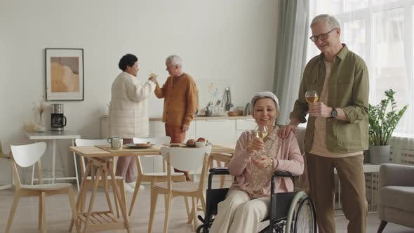 Man and Handicapped Wife Clinking Glasses