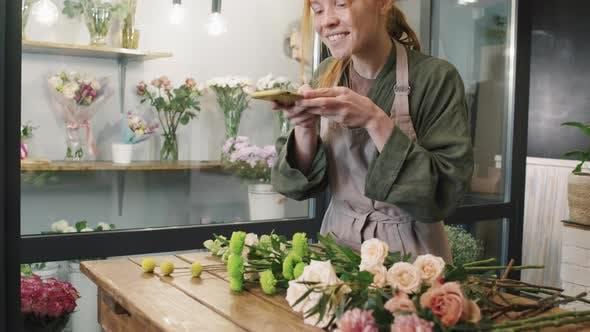 Beautiful Florist Taking Photos Of Flowers