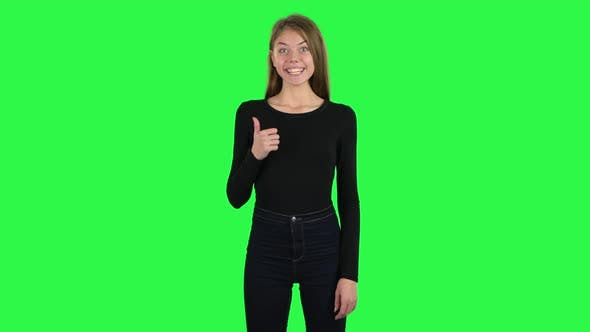Cover Image for Young Cheerful Woman Showing Thumbs Up, Gesture Like. Green Screen