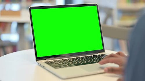 Male Hands Using Laptop with Green Chroma Key Screen Close Up