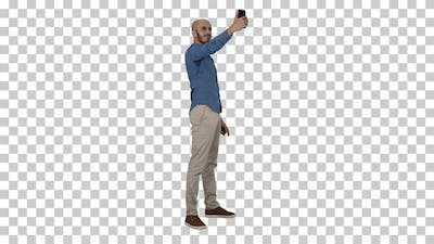 Selfie time! Handsome young man taking selfie with his phone