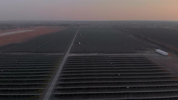 Thumbnail for Aerial Drone View Into Large Solar Panels at a Solar Farm. Solar Cell Power Plants. Footage Video .
