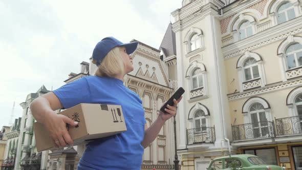 Thumbnail for Delivery Woman with Parcel Box Using Smart Phone Online Map
