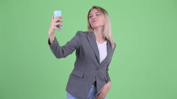 Thumbnail for Happy Young Blonde Businesswoman Taking Selfie and Video Calling
