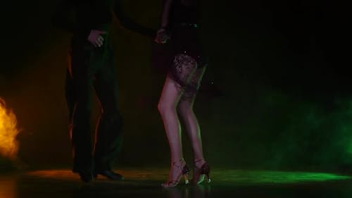 Dance Element From the Rumba, Slow Motion. Orange Green Background
