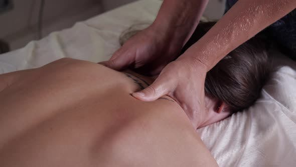 The Procedure of Relaxing Neck Massage in the Beauty Salon.