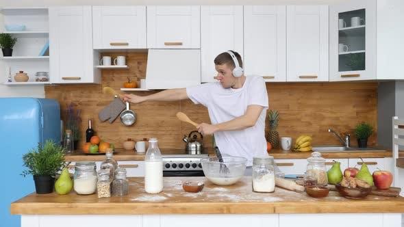 Happy, Inspiring, Uplifting Lifestyle Concept. Man Dancing In Kitchen. Good Morning.