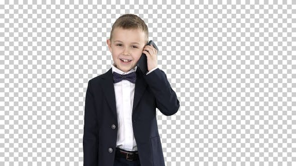 Cover Image for Little Boy in A Costume Making a Phone Call While Walking Alpha