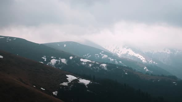 Mountains with Cloudy Sky