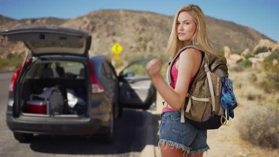 Thumbnail for Young attractive woman comes across abandoned vehicle in the desert