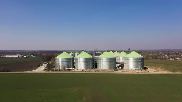 Aerial View of the Grain Silo's Elevator Near the Fields in Spring
