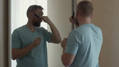 Bearded Man Combing His Beard