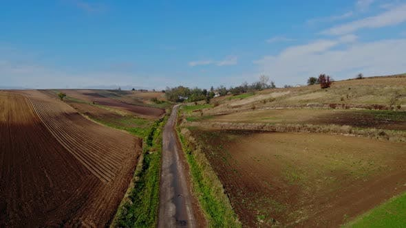 A flight over cultivated fields.