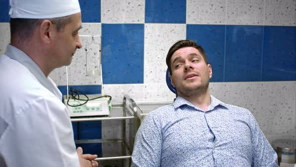 Thumbnail for Professional Dentist Talking with His Young Male Patient at Dental Clinic