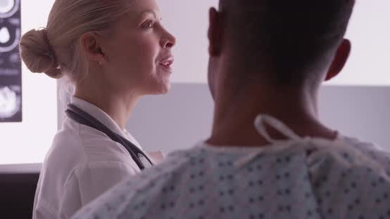 Thumbnail for Woman doctor explaining x-rays with male patient