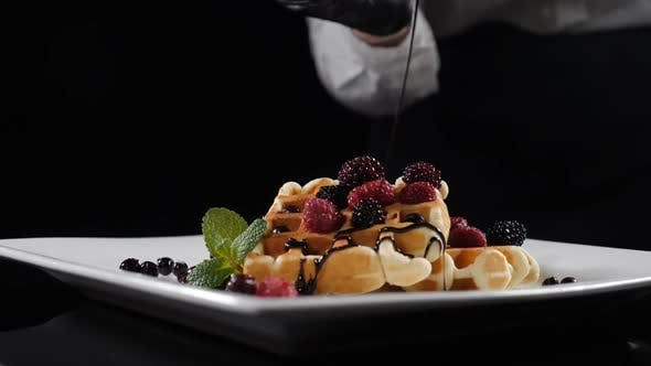 Thumbnail for Chocolate Sauce Pouring on Belgian Waffles. Sweet Breakfast Food, Unhealthy Eating. Sugar Food