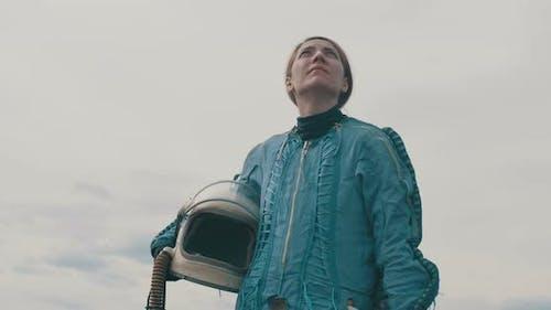 Female Astronaut Looking Towards Sky