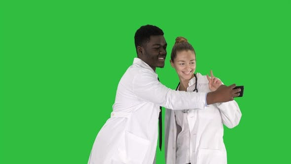 Thumbnail for Two doctors are making selfie using a smartphone and smiling
