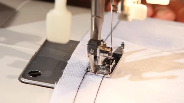 Thumbnail for Sew on the Sewing Machine White Cloth. Close Up