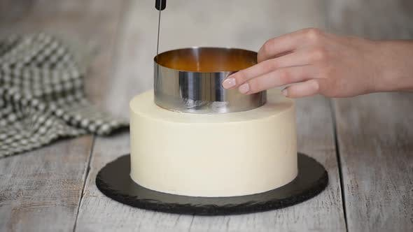 Thumbnail for The Pastry Chef Prepares and Decorated Cake with Orange Jelly