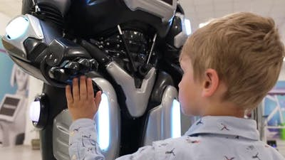 Children Look at a Humanoid Robot at the Exhibition