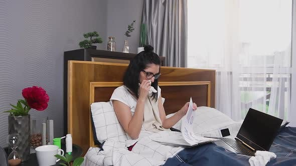 Young Woman Working Distantly at Home During Influenza or Angina Disease