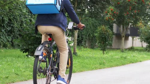 Delivery Man with Bag Riding Bicycle