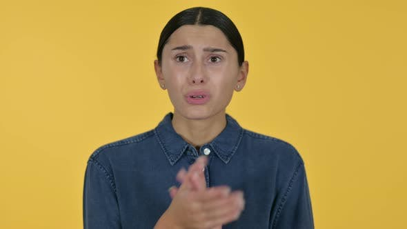 Thumbnail for Disappointed Latin Woman Having Loss, Yellow Background
