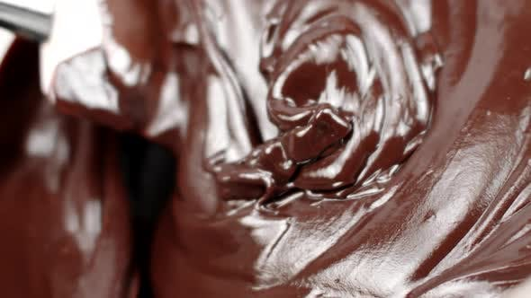 Thumbnail for Spatula Mixes Thick Mass Melted Chocolate for Delicious Cakes Close Up Slow Mo